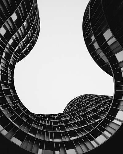 black-and-white grayscale photo of low angle view of building spiral