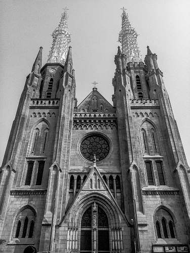 spire grayscale photography of cathedral black-and-white