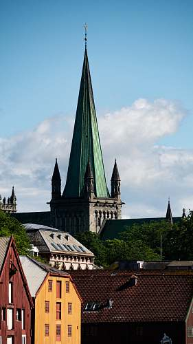 building green and grey church steeple spire