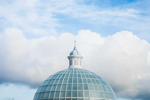 building green and white dome tower under white and blue sky at daytime dome