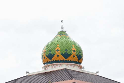building green and yellow temple dome
