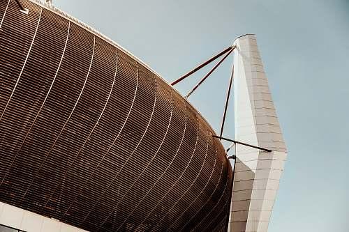 building grey coliseum with mesh planetarium