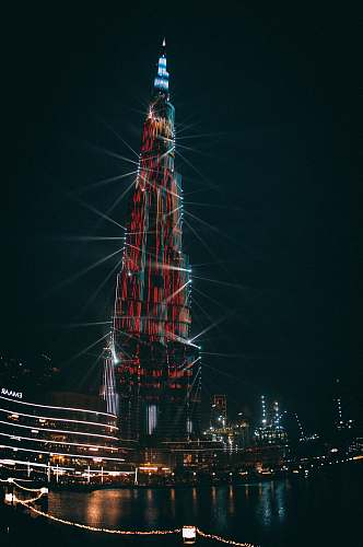building high-rise building during nighttime spire