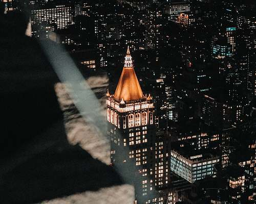 building high rise building view at night spire