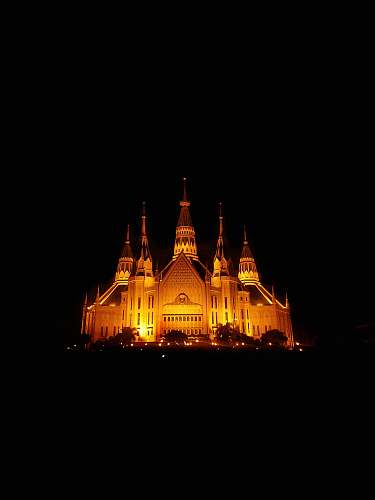 building lighted castle at night spire