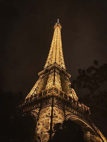 building lighted Eiffel tower during nighttime spire