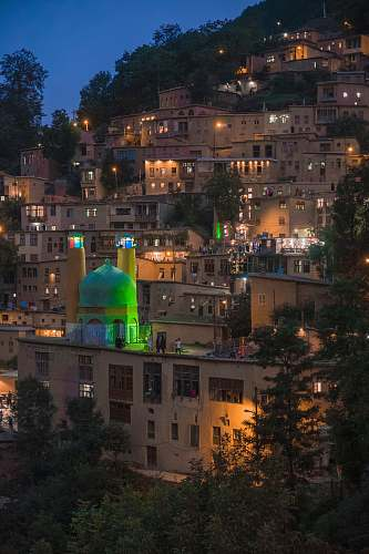 building lighted houses on hill dome