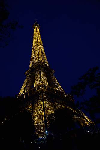 building low angle photo of Eiffel Tower at night spire