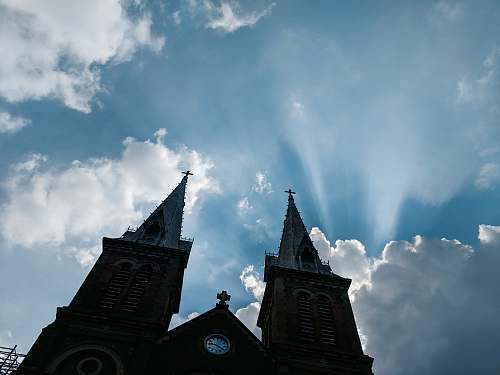 building low-angle photo silhouette of cathedral under blue sky spire