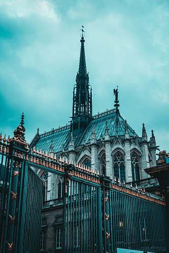 building low-angle photography of blue and gray cathedral spire