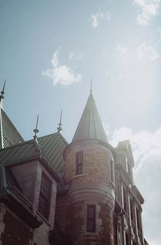 building low angle photography of castle under clear sky spire