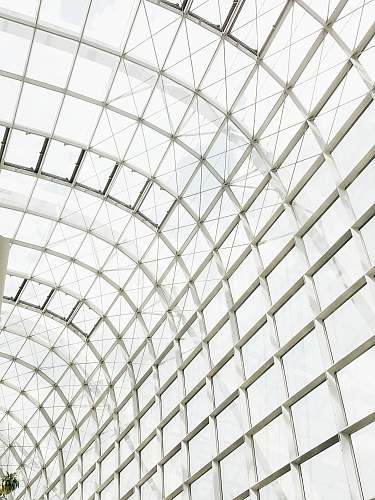 building low angle photography of clear glass ceiling window