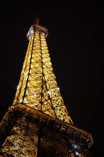 building low angle photography of Eiffel tower in Paris at night tower