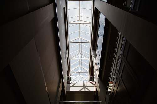 building low angle photography of inside building skylight