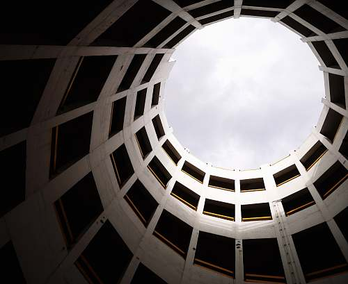 building low angle photography of white concrete building skylight