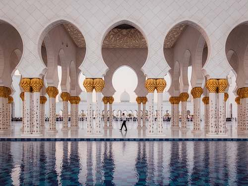 dome man walking on near swimming pool mosque