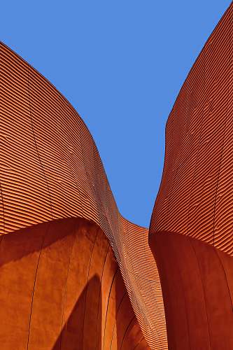 building minimalist photography of brown wavy structure roof