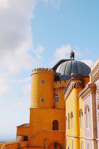 building orange and grey castle turret dome