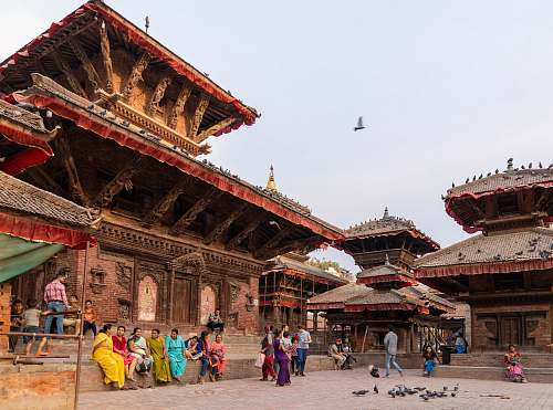 building people standing beside temple housing