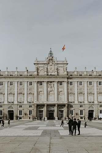 palace people walking near Royal Palace of Madrid house