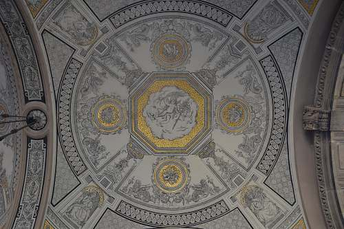 dome photo of white, gray, and yellow building ceiling grey