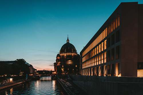 building photography of river beside building during sunset dome