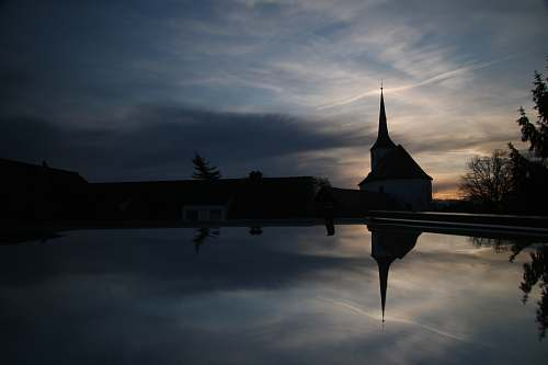 building silhouette church near body of water spire