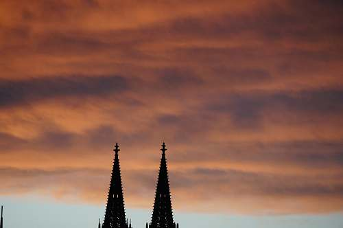 building silhouette photography of towers spire