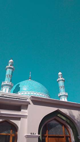 building teal and white mosque dome