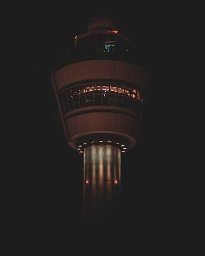 building turned-on lights on tower tower