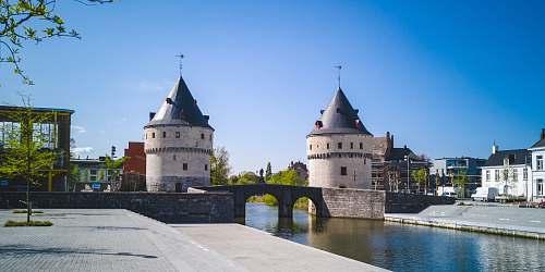 building two gray concrete castles near bridge castle