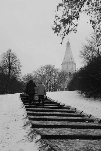 building two people walking on stairs black-and-white