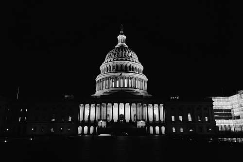 building United States Capitol, Washington DC during night black-and-white
