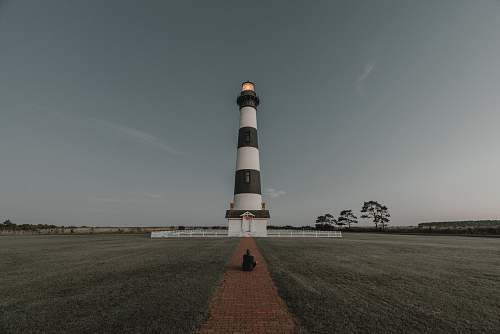 building white and black lighthouse miniature tower