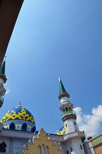 building white and blue concrete mosque dome