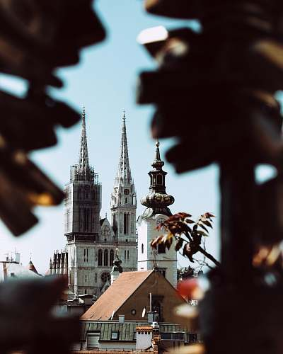 building white and brown cathedral building spire