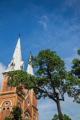 building white and brown church steeples spire