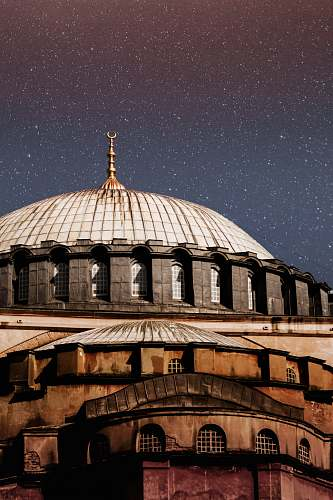 building white and brown domed building under starry sky dome