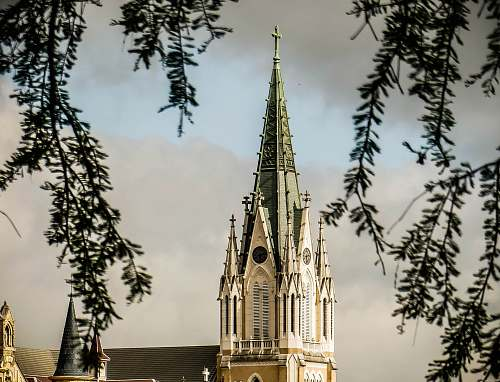 building white and green church steeple tower