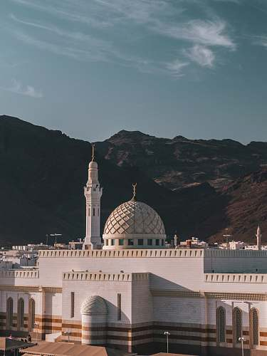 building white building near mountain during daytime dome