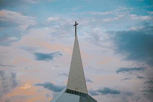 building white church under blue sky during daytime spire