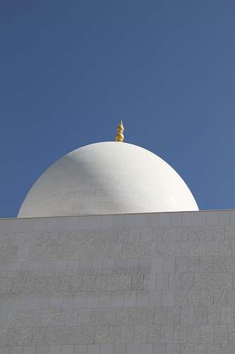 building white concrete mosque during daytime dome