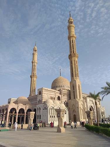 building white concrete mosque under cloudy sky dome