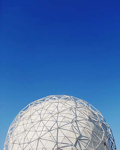 building white metal dome under blue sky dome