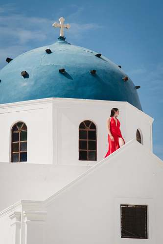 building woman in red sleeveless dress dome