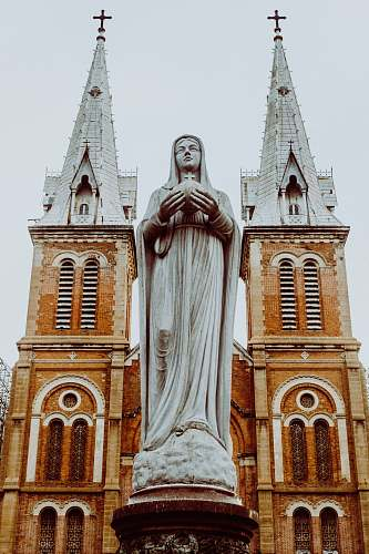 building woman religious statue tower