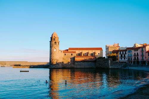 architecture beige castle near body of water castle
