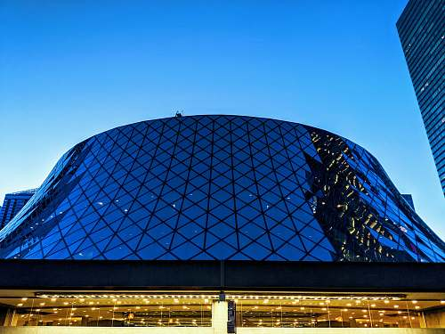 architecture gray and black metal and glass building planetarium