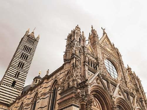 architecture gray church during daytime spire