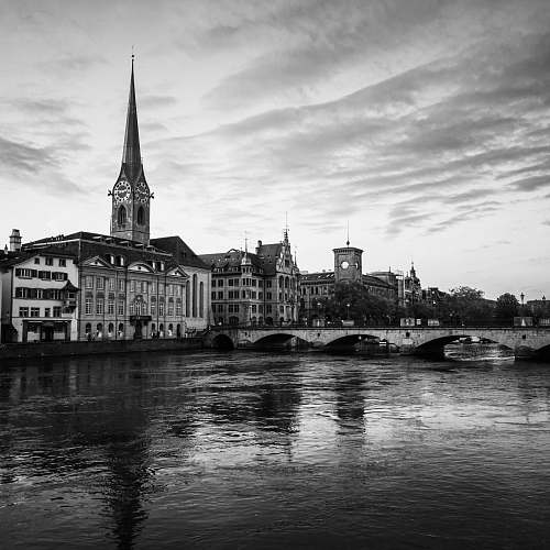 architecture grayscale photo of buildings near body of water black-and-white